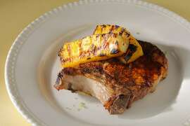 Spiced pork chops with grilled pineapple as seen in San Francisco, California, on Wednesday, June 19, 2013. Food styled by Amanda Gold.