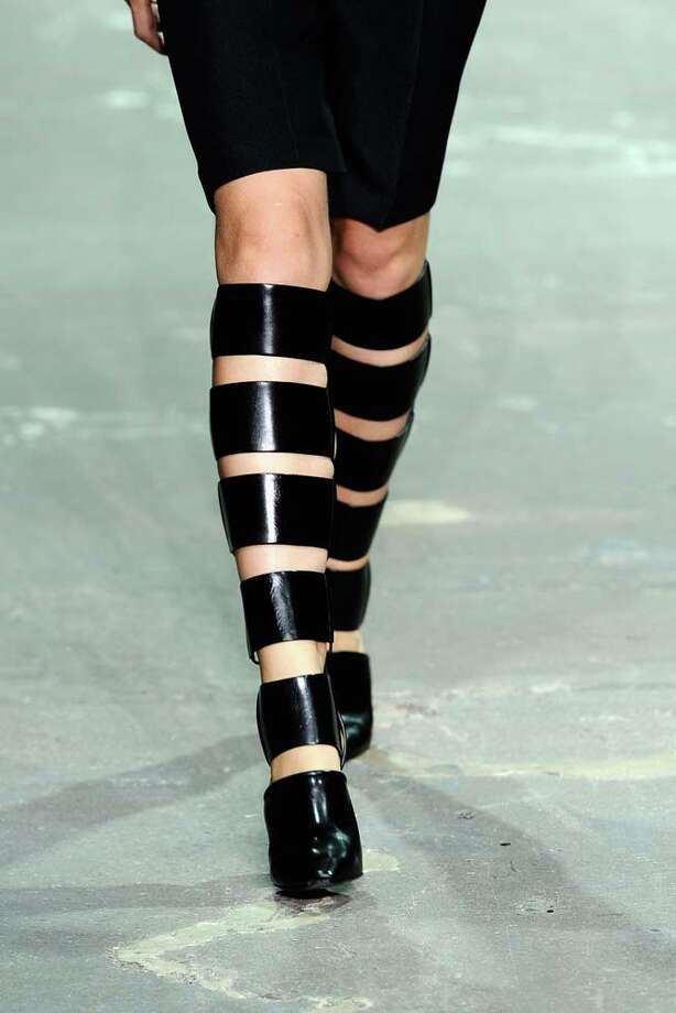 These are either boots, or strap-on leg warmers. Photo: Fernanda Calfat, Getty Images For Mercedes-Benz Fashion Week / 2012 Getty Images