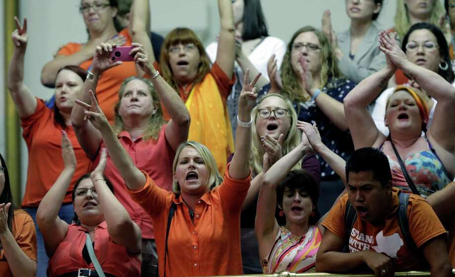 Members of the gallery cheer and chant as the Texas Senate tries to bring an abortion bill to a vote as time expires, Wednesday, June 26, 2013, in Austin, Texas. Amid the deafening roar of abortion rights supporters, Texas Republicans huddled around the Senate podium to pass new abortion restrictions, but whether the vote was cast before or after midnight is in dispute. If signed into law, the measures would close almost every abortion clinic in Texas. Photo: Eric Gay