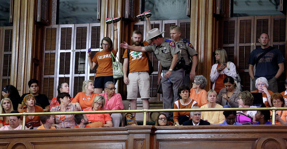 Spectators show support as Fort Worth Senator Wendy Davis filibusters in an effort to cause abortion legislation to die without a vote on the floor of the Senate Tuesday, June 25, 2013. Photo: TOM REEL