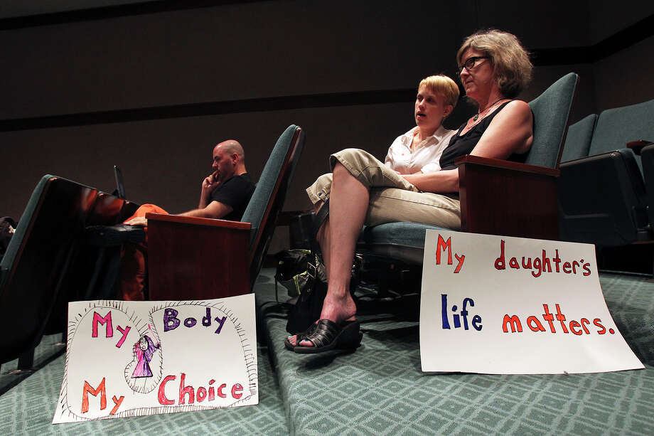 Kathy Bylenok watches with her daughter Tasha Bylenok in an overflow room for spectators as Fort Worth Senator Wendy Davis filibusters in an effort to cause abortion legislation to die without a vote on the floor of the Senate Tuesday, June 25, 2013. Photo: TOM REEL