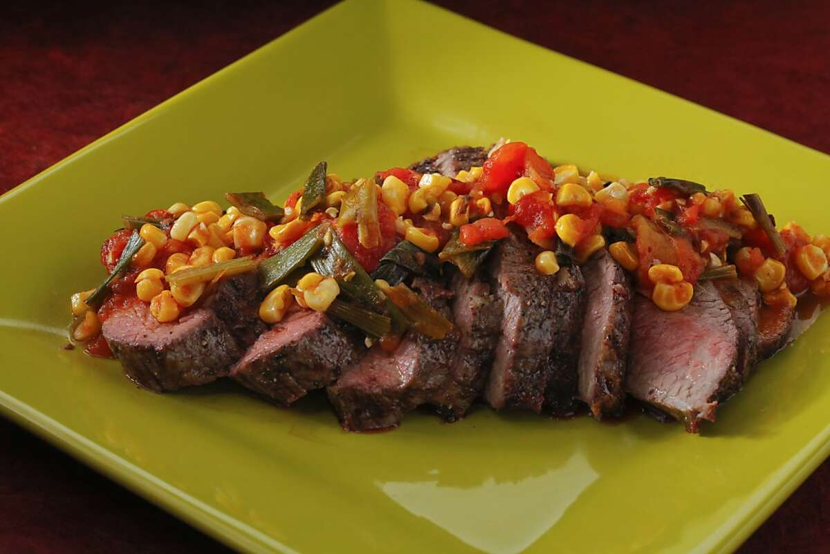 Grilled tri-tip roast with charred tomato-corn relish as seen in San Francisco, California, on June 12, 2013. Food styled by Tara Duggan.