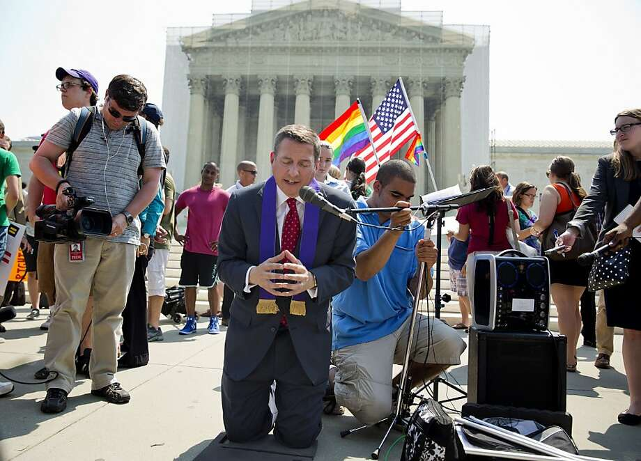 The Rev. Rob Schenck, an opponent of same-sex marriage, prays after the Supreme Court's rulings on the issue Wednesday. Photo: Joshua Roberts, Bloomberg