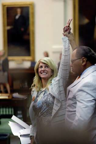 Sen. Wendy Davis, D-Fort Worth, left, who tries to  filibuster an abortion bill, reacts as time expires, Tuesday, June 26, 2013, in Austin, Texas. Amid the deafening roar of abortion rights supporters, Texas Republicans huddled around the Senate podium to pass new abortion restrictions, but whether the vote was cast before or after midnight is in dispute. If signed into law, the measures would close almost every abortion clinic in Texas. Photo: Eric Gay