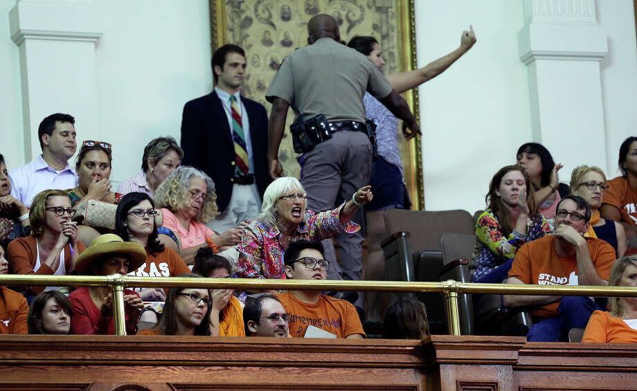 Vociferous spectators are removed from the chamber after Fort Worth Senator Wendy Davis is stopped in her  filibuster in an effort to cause abortion legislation to die without a vote on the floor of the Senate Tuesday, June 25, 2013. Photo: TOM REEL