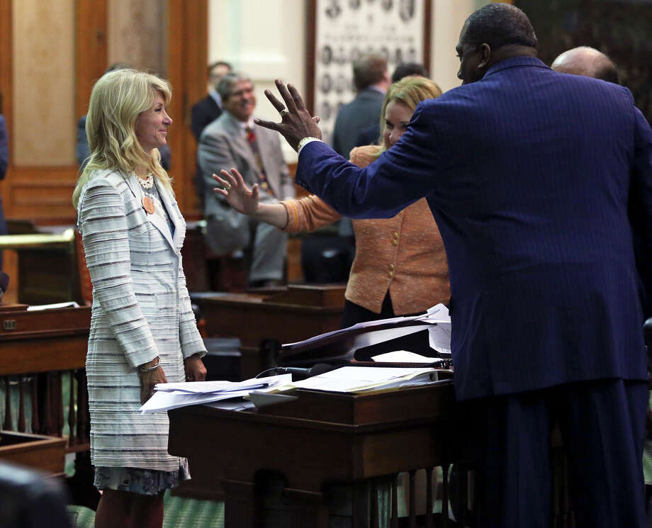 Senators Royce West  D-Dallas and Sylvia Garcia D-Houston motion to Fort Worth Senator Wendy Davis  who filibusters in an effort to cause abortion legislation to die without a vote on the floor of the Senate Tuesday, June 25, 2013. Photo: TOM REEL