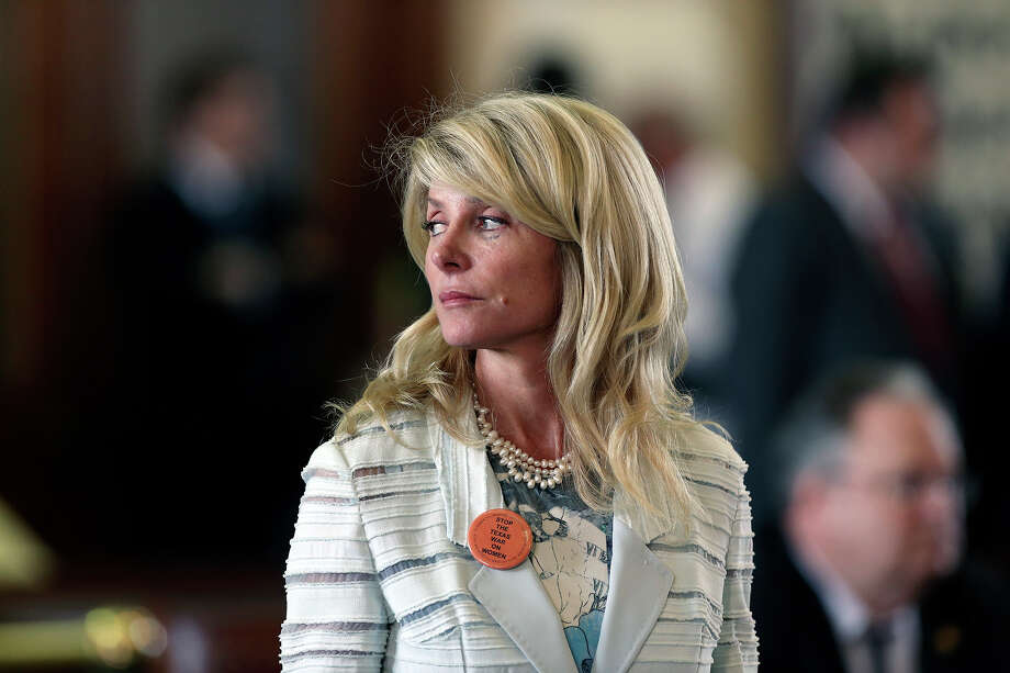 Fort Worth Senator Wendy Davis takes a moment to look away as a parliamentary point is debated as she filibusters in an effort to cause abortion legislation to die without a vote on the floor of the Senate Tuesday, June 25, 2013. Photo: TOM REEL