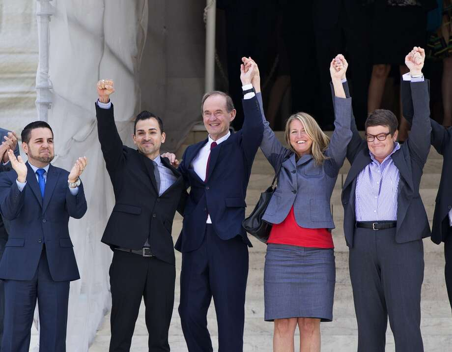 Plaintiffs in Hollingsworth v. Perry, the California Proposition 8 case - Jeff Zarillo, left, his partner Paul Katami, attorney David Boies Sandy Stier and her partner, Kris Perry -  react to the high court's ruling. Photo: J. Scott Applewhite, STF / AP