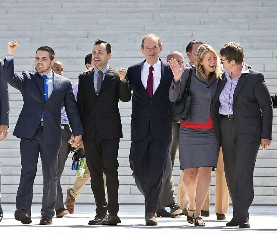 Plaintiffs Jeff Zarrillo and his partner Paul Katami, attorney David Boies, and plaintiffs Sandy Stier and her partner Kris Perry on the steps of the U.S. Supreme Court after the ruling in their favor in the Proposition 8 case. Photo: J. Scott Applewhite, Associated Press