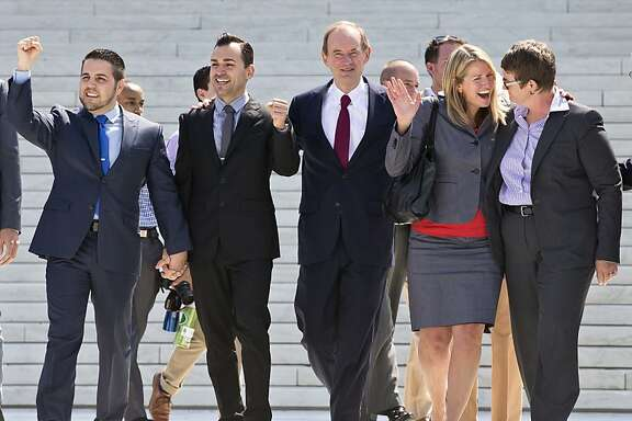 Plaintiffs and lawyers in Hollingsworth v. Perry, the California Proposition 8 case, react on steps of the Supreme Court in Washington, Wednesday, June 26, 213, after justices cleared the way for the resumption of same-sex marriage in California. From left are, plaintiffs Jeff Zarrillo and his partner Paul Katami, attorney David Boies, and plaintiffs Sandy Stier and her partner Kris Perry.  (AP Photo/J. Scott Applewhite)