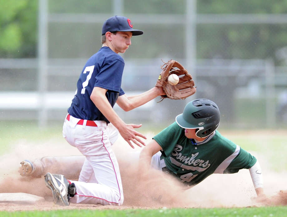 At left, Greenwich Cannons second baseman Ricky Columbo takes a late throw as Chris Mulholland of  Croton-on-Hudosn steals second in the bottom of the third inning in a 15U baseball game at Julian Curtiss Elementary School in Greenwich, Wednesday, June 26, 2013. Photo: Bob Luckey / Greenwich Time