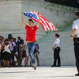 Julio Diaz, 28, center, of Chicago, Illinois, celebrates after the Supreme Court ruled 5-4 to strike down the Defense of Marriage Act, Wednesday, June 26, 2013, in Washington, D.C. (Pete Marovich/MCT)