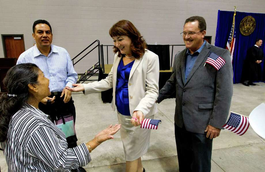 Natalia de las Cuevas, center, greets Saturnina Garcia after a naturalization ceremony at the M.O. Campbell Educational Center on Wednesday. Photo: Cody Duty, Staff / © 2013 Houston Chronicle