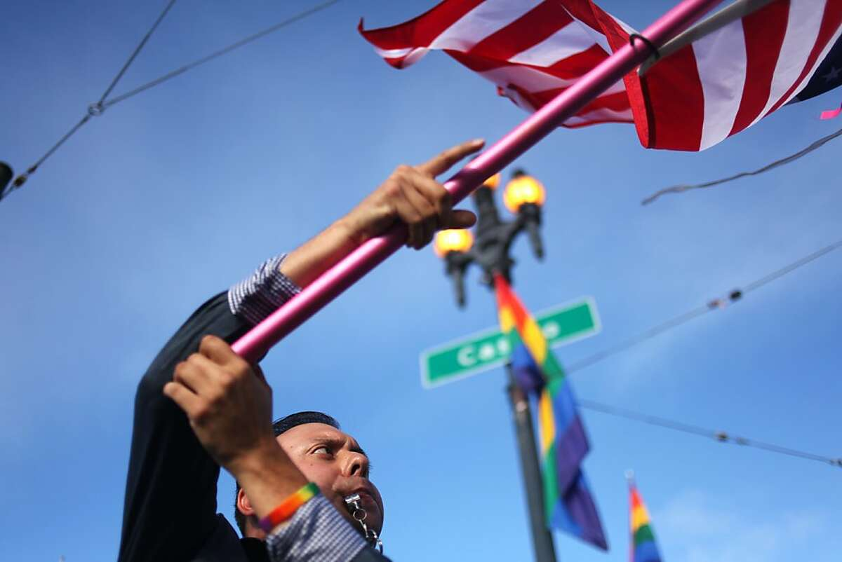 Enrique Chavez celebrates the Supreme Court decision on DOMA/Prop 8 at the intersection of Market and Castro streets on June 27, 2013 in San Francisco, Calif.