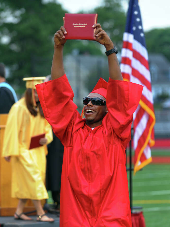Graduate Bernard Brantley holds his diploma high in the air during Stratford High School's 124th Annual Commencement in Stratford, Conn. on Wednesday June 26, 2013. Photo: Christian Abraham / Connecticut Post