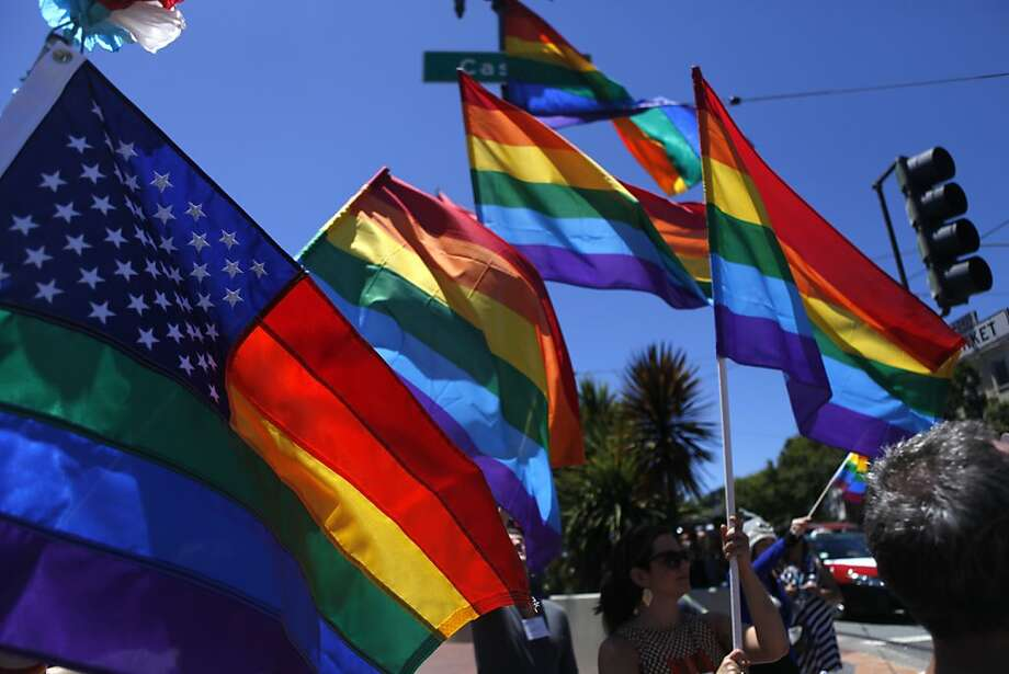 LGBT flags fly at the corner of Market and Castro on June 26 2013 in San Francisco, Calif. in celebration of the new verdict on same sex marriage. Photo: Katie Meek, The Chronicle