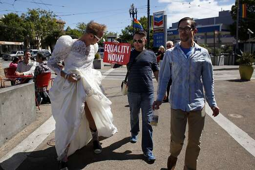 Jerry Deal, left, wears his wedding gown as he and Marvin Dunson and Ted Garey walk through the Castro district to celebrates the United States Supreme Court ruling that Section 3 of the federal Defense of Marriage Act is unconstitutional and that California's Proposition 8 has been struck down, Wednesday June 26, 2013, in San Francisco, Calif. Photo: Lacy Atkins, The Chronicle