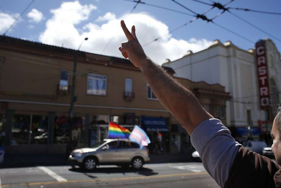 Sergio Cabrera, visiting form San Diego, shows his pride as supporters drive down Castro street, in San Francisco, Calif.,  Wednesday June 26, 2013, after United States Supreme Court ruled that Section 3 of the federal Defense of Marriage Act was unconstitutional and that California's Proposition 8 was struck down. Photo: Lacy Atkins, The Chronicle