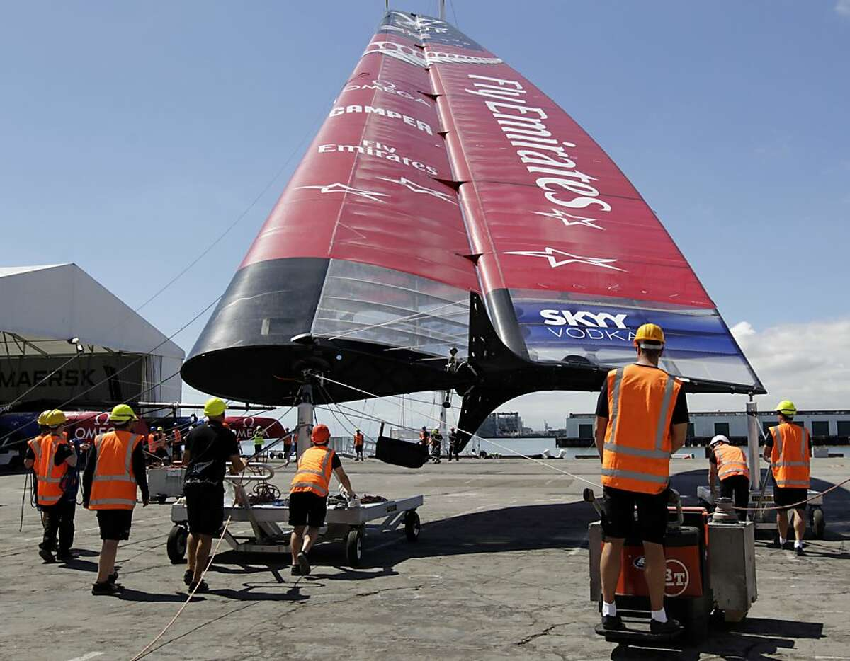 The shore crew for Emirates Team New Zealand prepares one of the huge wing sails for installation onto the AC-72 boat at the team's compound in San Francisco, Calif. on Wednesday, June 26, 2013. New Zealand squares off against Italy's Luna Rossa and Artemis Racing of Sweden in the Louis Vuitton Cup with the winner earning the right to challenge Oracle Team USA, the defender of the America's Cup.