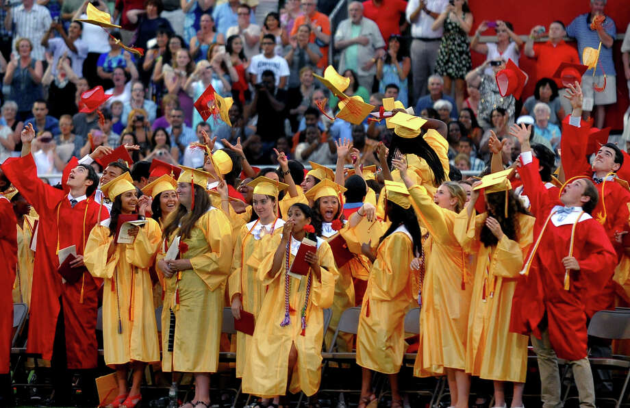 Graduates toss their caps into the air during Stratford High School's 124th Annual Commencement in Stratford, Conn. on Wednesday June 26, 2013. Photo: Christian Abraham / Connecticut Post