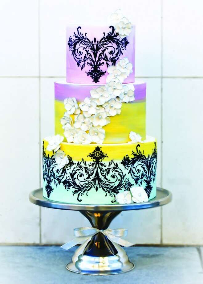 Silk painted in mint, sunflower, and magenta with white hydrangea tipped in silver with black royal icing detail by Beyond Buttercream. Photo: Picasa