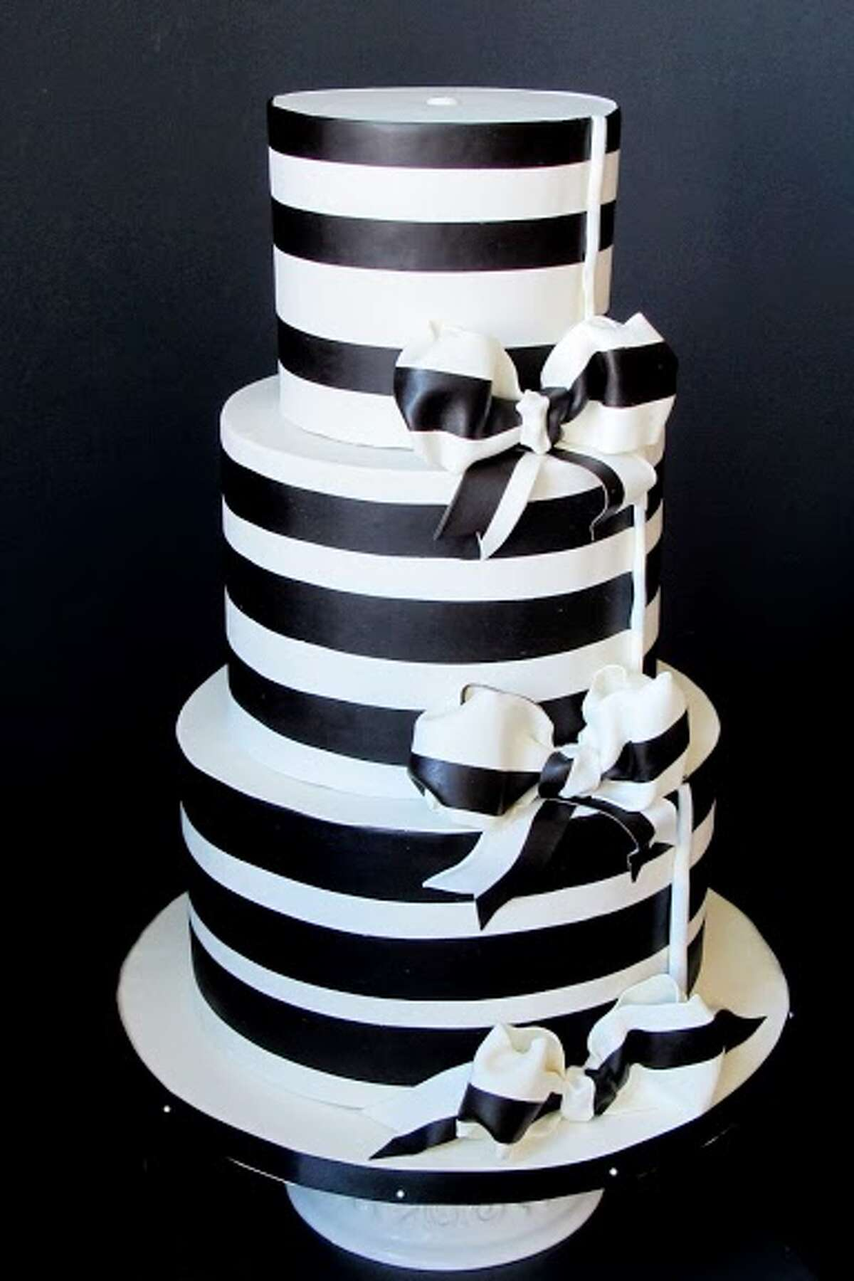 White and dark chocolate stripes on ganache by Beyond Buttercream.