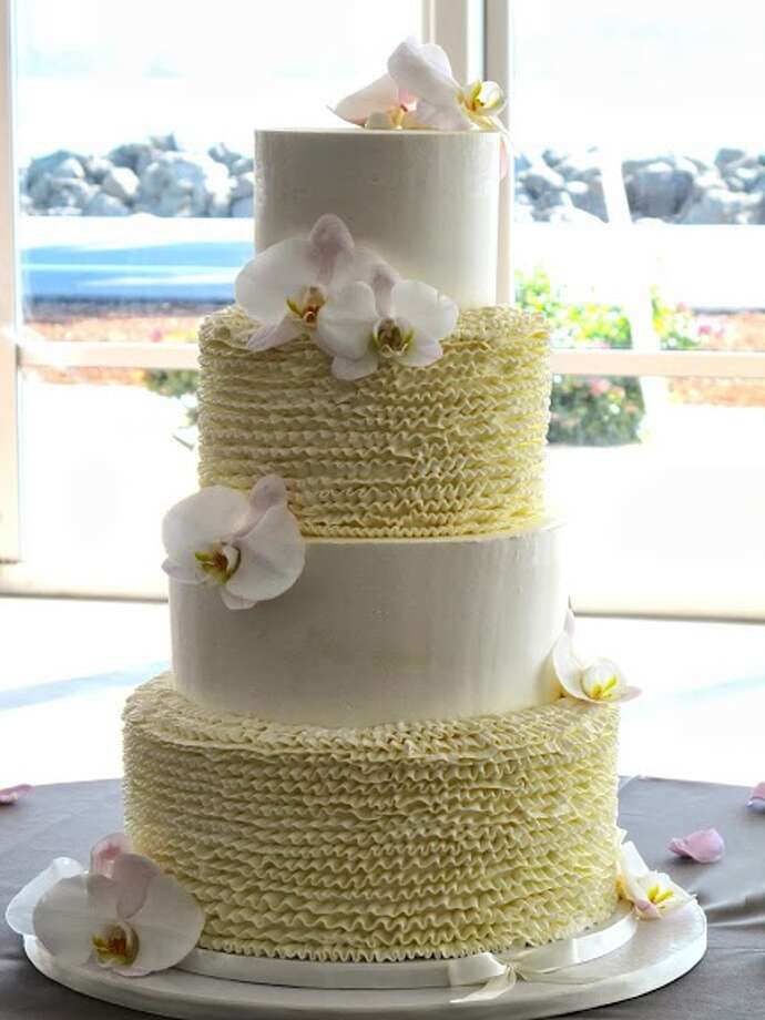 Butter cream and orchids by Beyond Buttercream. Photo: Picasa