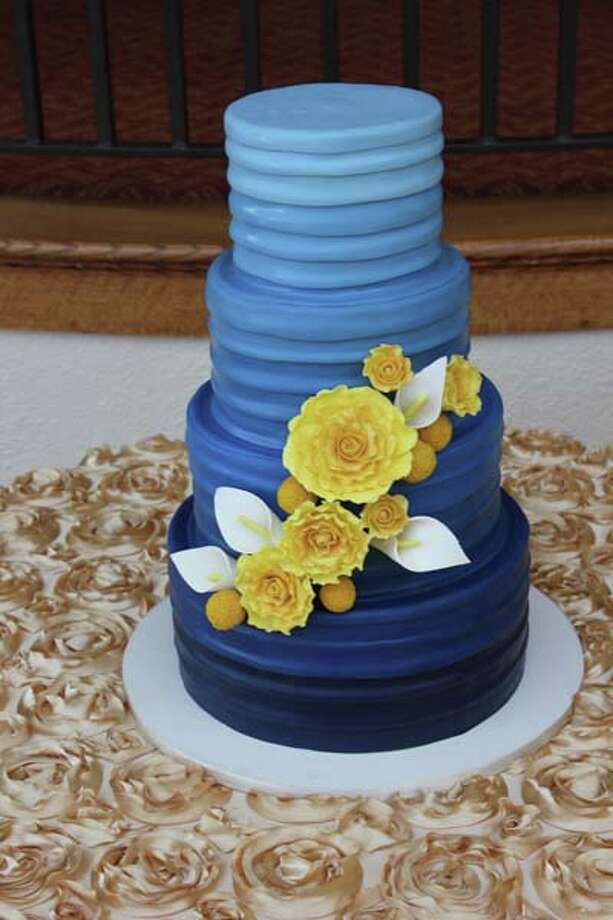 """ Navy ombre"" - hand colored, layered fondant bands with yellow sugar roses, Calla lilies and billy buttons by Cake Coquette."