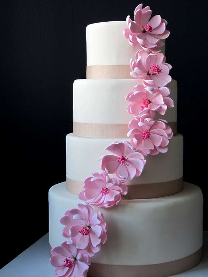 White fondant, with pink lotus sugar flowers by Beyond Buttercream.