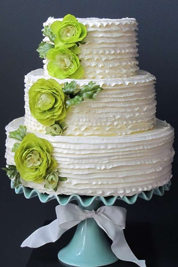 Buttercream cake with green florals by Beyond Buttercream.