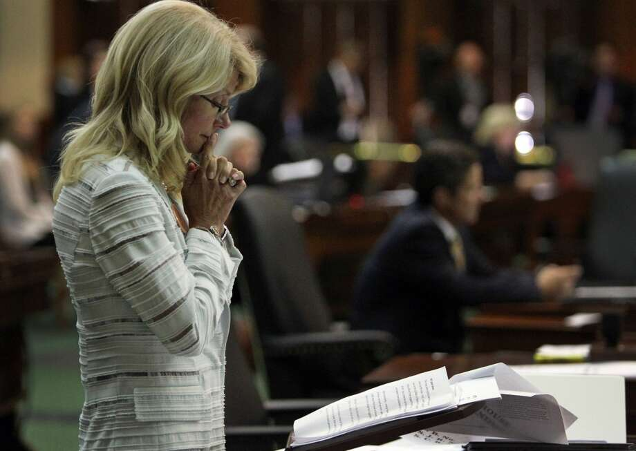 State Senator Wendy Davis spends a quiet moment after her filibuster was halted on the final day of the legislative special session, as the Senate considers an abortion bill, June 25, 2013, in Austin, Texas. Photo: Louis DeLuca, McClatchy-Tribune News Service