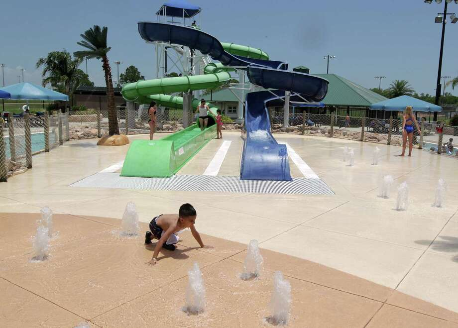 A boy plays in Pirates Bay Water Park Wednesday, June 26, 2013, in Baytown. Photo: James Nielsen, Houston Chronicle / © 2013  Houston Chronicle