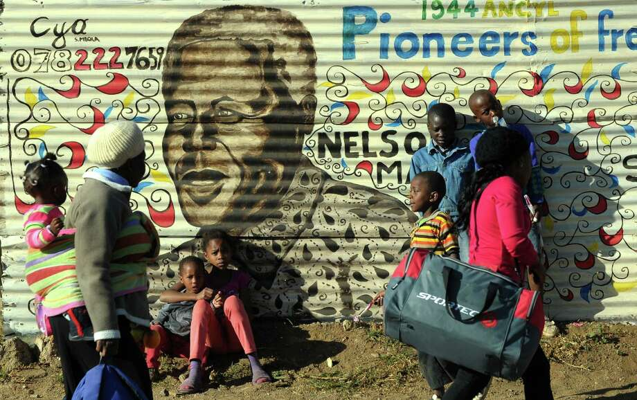 A mural praises former South African President Nelson Mandela in Soweto. The ailing 94-year-old former leader is in critical condition in a Pretoria hospital. Photo: ALEXANDER JOE, Staff / AFP