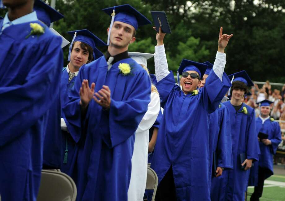 Graduate Felix Garcia celebrates during commencement at Bunnell High School in Stratford, Conn. Wednesday, June 26, 2013. Photo: Autumn Driscoll / Connecticut Post