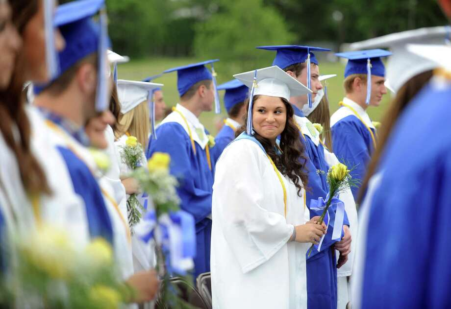 Graduate Sarah Stein looks back at a friend during commencement at Bunnell High School in Stratford, Conn. Wednesday, June 26, 2013. Photo: Autumn Driscoll / Connecticut Post