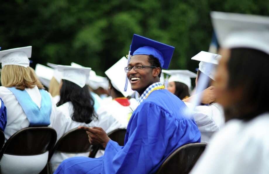 Graduate Isaiah Williams smiles during commencement at Bunnell High School in Stratford, Conn. Wednesday, June 26, 2013. Photo: Autumn Driscoll / Connecticut Post