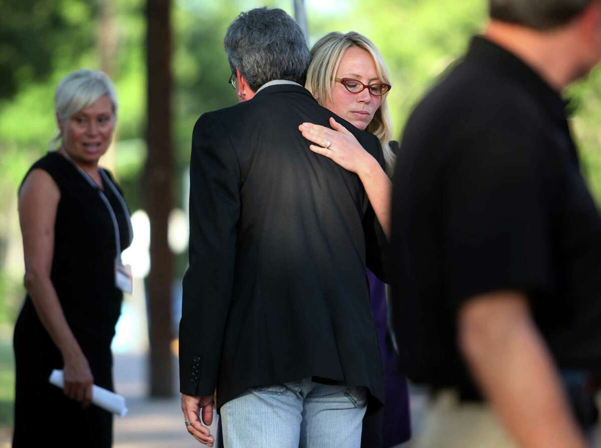 (Left to right) Leslie Lambert, granddaughter of victim, embraces a family friend after the execution of Kimberly McCarthy outside the Texas State Penitentiary ' Walls Unit' on Wednesday, June 26, 2013, in Huntsville. Kimberly McCarthy is the state's 500th execution since state resumed capital punishment in 1982.