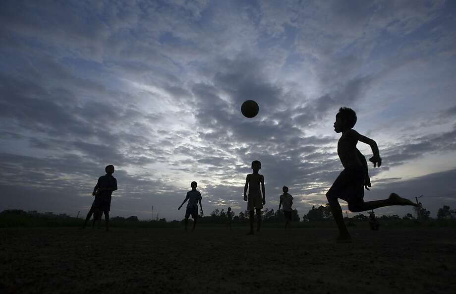 Young Indian children play football on the outskirts of the eastern Indian city Bhubaneswar, India, Wednesday, June 26, 2013. (AP Photo/Biswaranjan Rout) Photo: Biswaranjan Rout, Associated Press