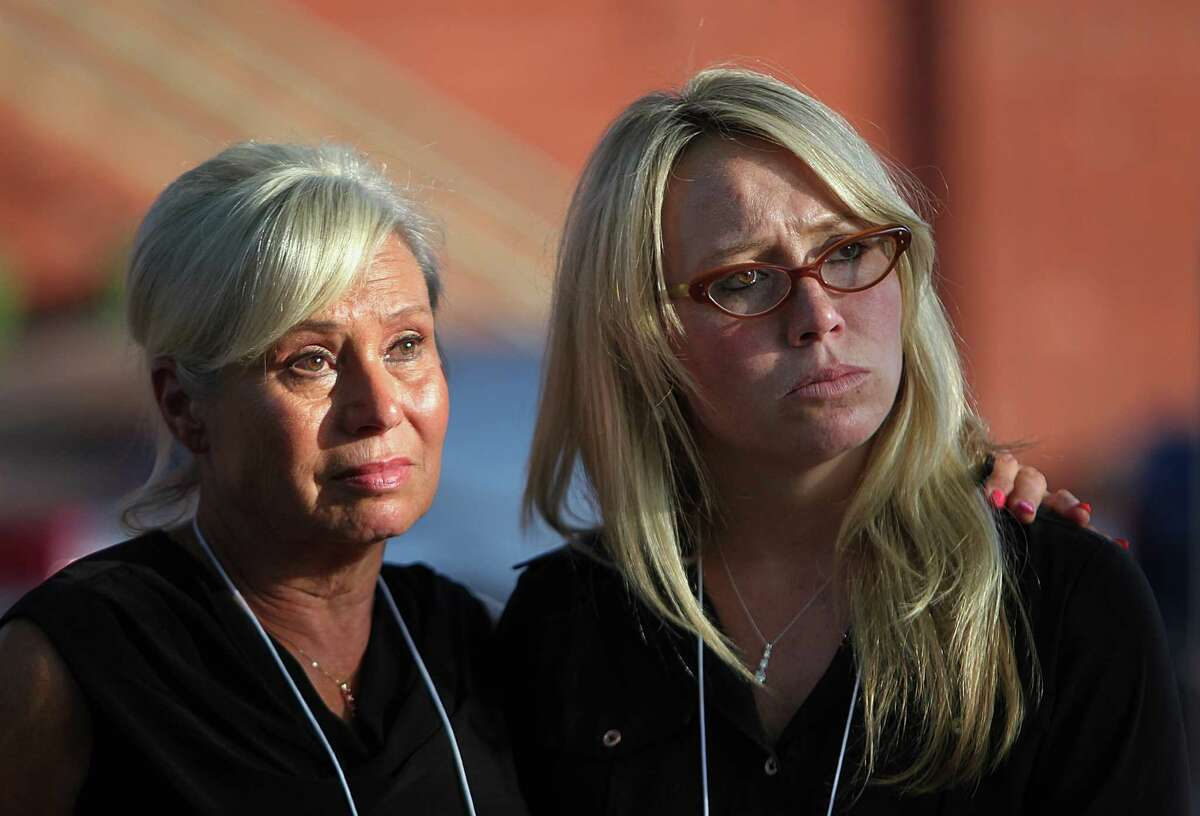 (Left to right) Donna Aldred, daughter of victim, embraces daughter Leslie Lambert after the execution of Kimberly McCarthy outside the Texas State Penitentiary ' Walls Unit' on Wednesday, June 26, 2013, in Huntsville. Kimberly McCarthy is the state's 500th execution since state resumed capital punishment in 1982.