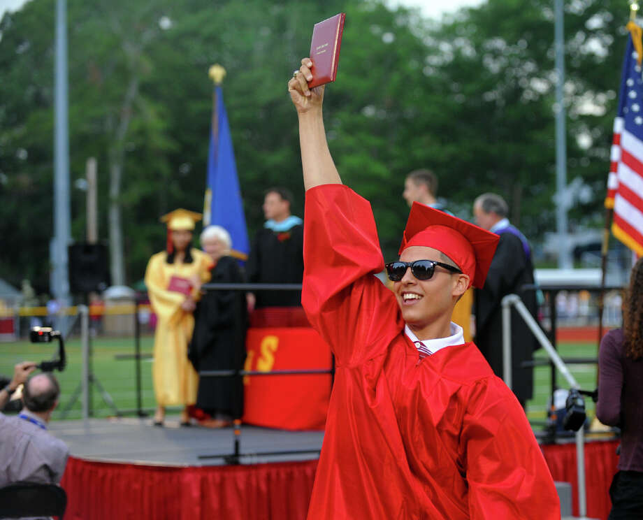 Graduate Miguel Morales holds his diploma high in the air during Stratford High School's 124th Annual Commencement in Stratford, Conn. on Wednesday June 26, 2013. Photo: Christian Abraham / Connecticut Post