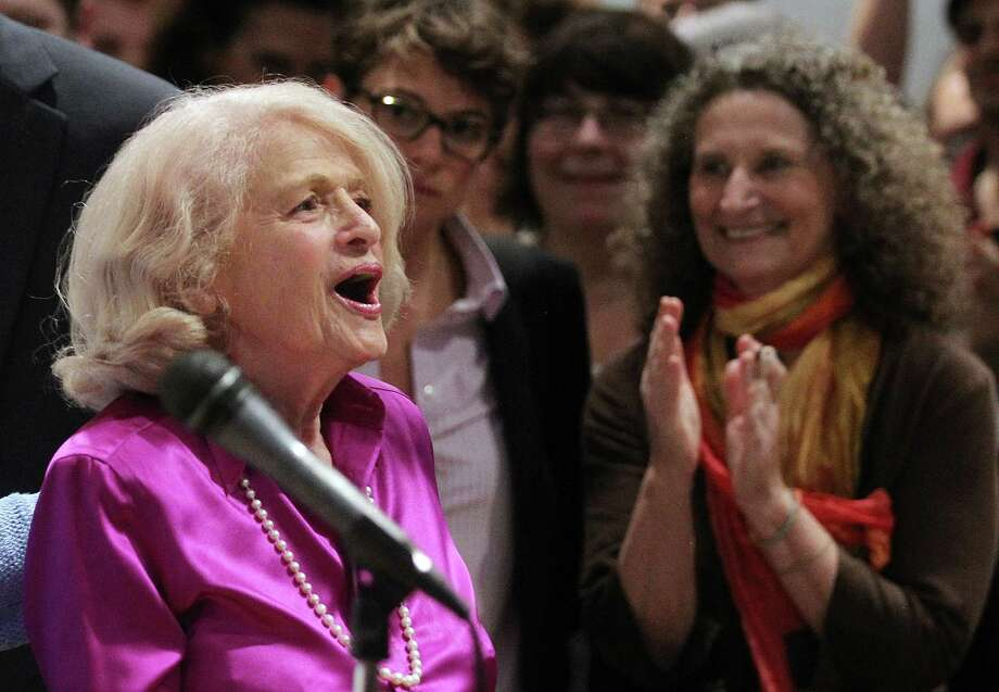 "NEW YORK, NY - JUNE 26:  Defense of Marriage Act (DOMA) plaintiff Edith ""Edie"" Windsor (L) speaks to supporters in Manhattan following the U.S. Supreme Court ruling on DOMA on June 26, 2013 in New York City. It was the death of Windsor's life partner of 42 years, Thea Clara Spyer, which led to the case. The high court struck down the Defense of Marriage Act (DOMA) and ruled that supporters of California's ban on gay marriage, Proposition 8, could not defend it before the Supreme Court.  (Photo by Mario Tama/Getty Images) ORG XMIT: 171706260 Photo: Mario Tama / 2013 Getty Images"