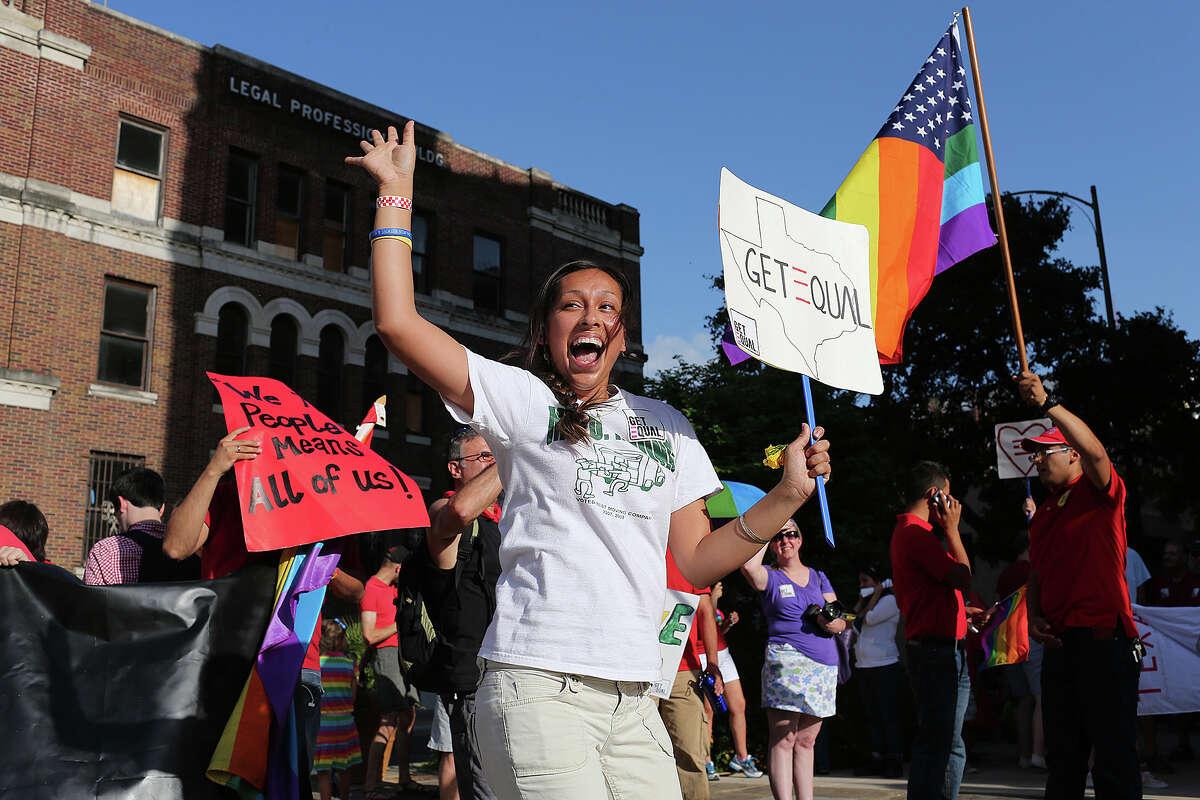 Dorothy Senac of San Antonio, celebrates at