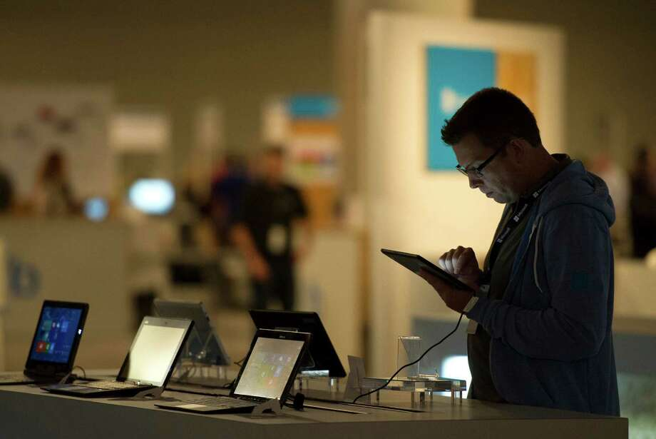 An attendee uses the touch screen on Microsoft's Surface tablet during the Microsoft Build Developers Conference in San Francisco on Wednesday. Photo: David Paul Morris / © 2013 Bloomberg Finance LP