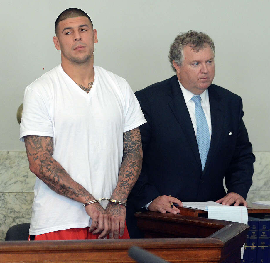 Aaron Hernandez, left, and his attorney, Michael Fee, seek bail but are denied it during Wednesday's arraignment proceedings. Photo: Mike George, POOL / Pool, The Sun Chronicle