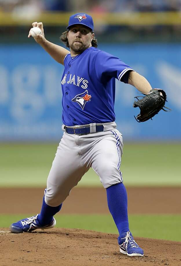 Toronto Blue Jays starting pitcher R.A. Dickey delivers to Tampa Bay Rays' Desmond Jennings during the first inning of a baseball game Wednesday, June 26, 2013, in St. Petersburg, Fla. (AP Photo/Chris O'Meara) Photo: Chris O'Meara, Associated Press