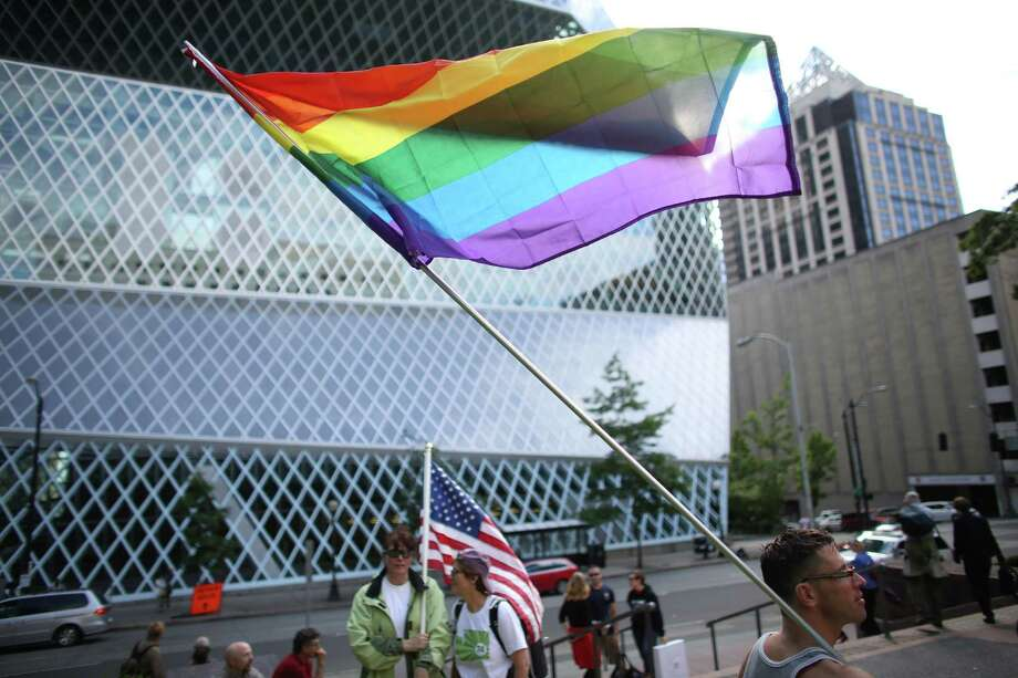 People gather on Wednesday, June 26, 2013 in front of the William Kenzo Nakamura United States Court of Appeals in downtown Seattle. Hundreds gathered there Wednesday afternoon after the United States Supreme Court struck down the Defense of Marriage Act and dismissed California's Proposition 8. Photo: JOSHUA TRUJILLO, SEATTLEPI.COM / SEATTLEPI.COM