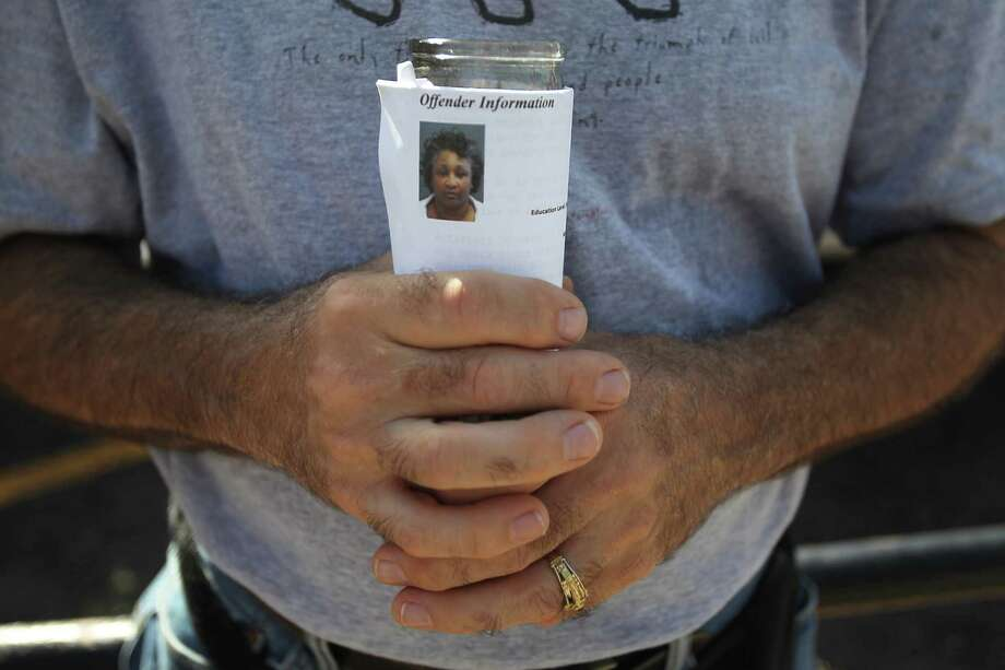 Dennis Longmire, of Huntsville, holds a candle for Kimberly McCarthy as he protest quietly outside the Texas State Penitentiary 'Walls Unit' on Wednesday, June 26, 2013, in Huntsville.  Kimberly McCarthy is the state's 500th execution since state resumed capital punishment in 1982. Photo: Mayra Beltran / © 2013 Houston Chronicle