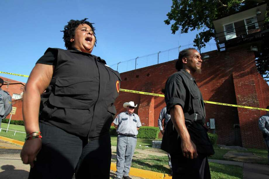 Krystal Muhammad, of the Houston New Black Panther Party, shouts at pro-death penalty demonstrators outside the Texas State Penitentiary ' Walls Unit' on Wednesday, June 26, 2013, in Huntsville. Photo: Mayra Beltran / © 2013 Houston Chronicle