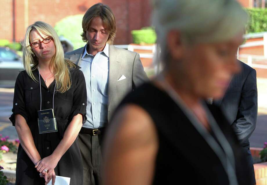 Leslie Lambert and husband Darrel Lambert listen to Donna Aldred, daughter of the victim, during a press conference outside the Texas State Penitentiary ' Walls Unit' on Wednesday, June 26, 2013, in Huntsville. Photo: Mayra Beltran / © 2013 Houston Chronicle