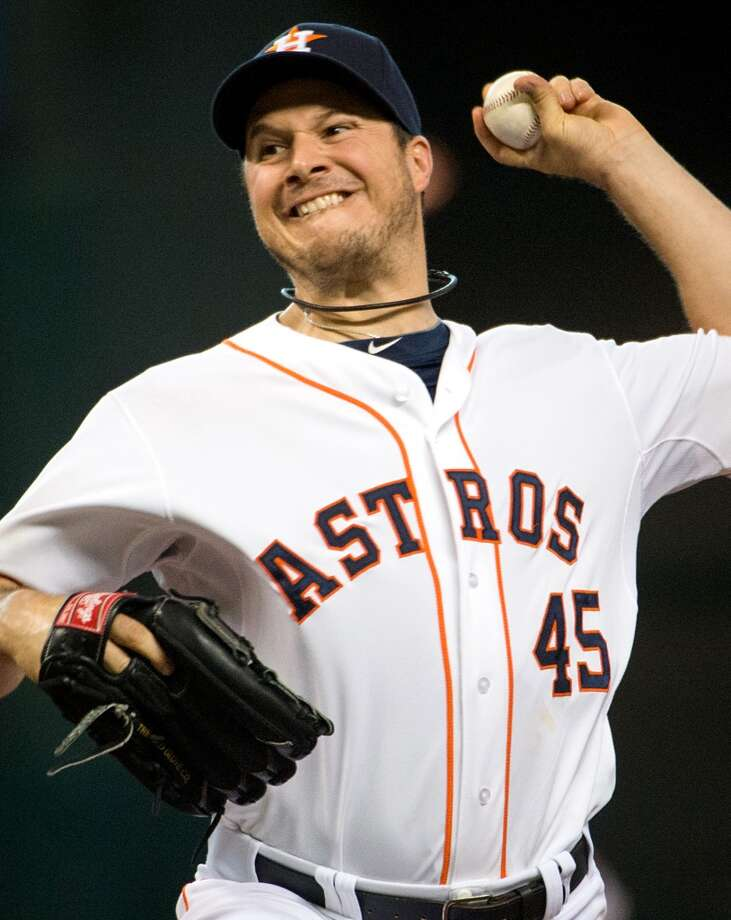 Astros starting pitcher Erik Bedard pitches during the second inning.